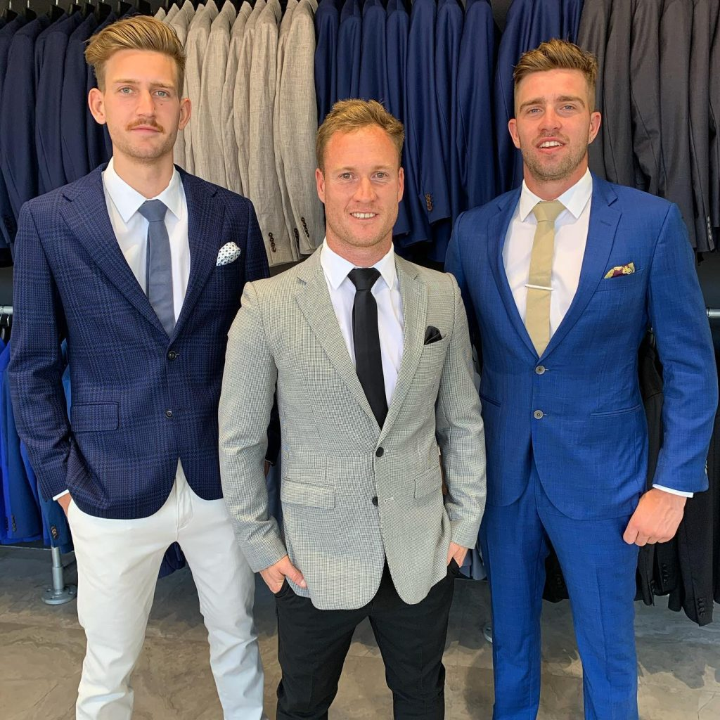 Luke Ryan wears vibrant navy suit at the races